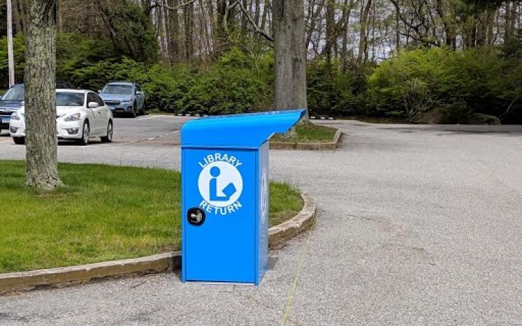 photograph of blue library book return bin